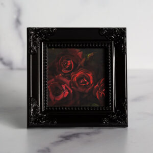 Photograph of a black frame with a photograph of Dark Knight Roses
