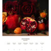 October 2022 wall calendar page with pomegranates and roses on it