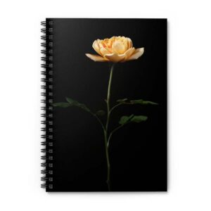 Photograph of spiral bound notebook with a single golden rose on the front of it