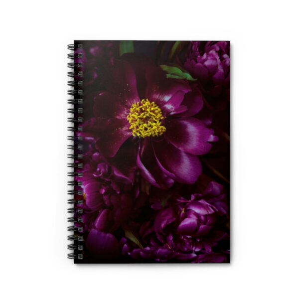 Photograph of a spiral bound notebook with purple peonies on it
