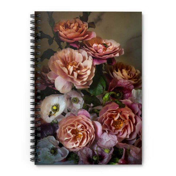 Photograph of spiral bound notebook with roses and poppies on the front of it